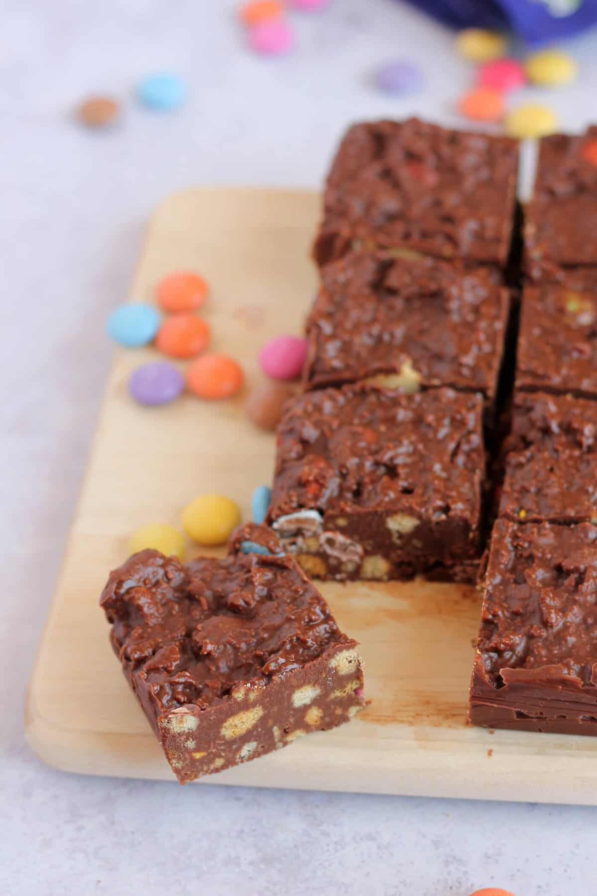 A close up picture of the biscuit cake, showing the chocolate, biscuit and candy layers.