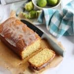 A slice of lime and coconut loaf cake