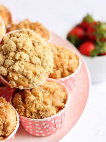A pile of strawberry muffins on a plate