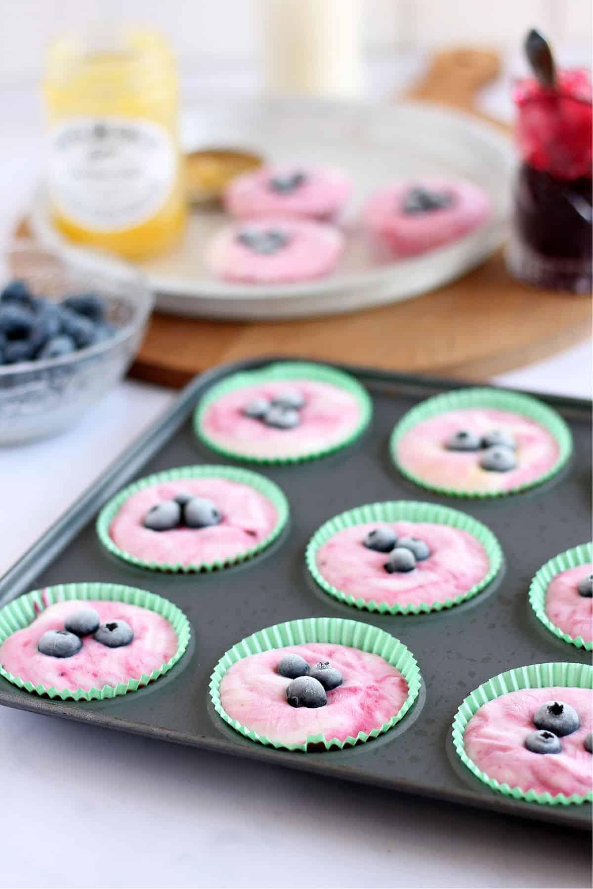 Frozen yogurt bites in cupcake cases.