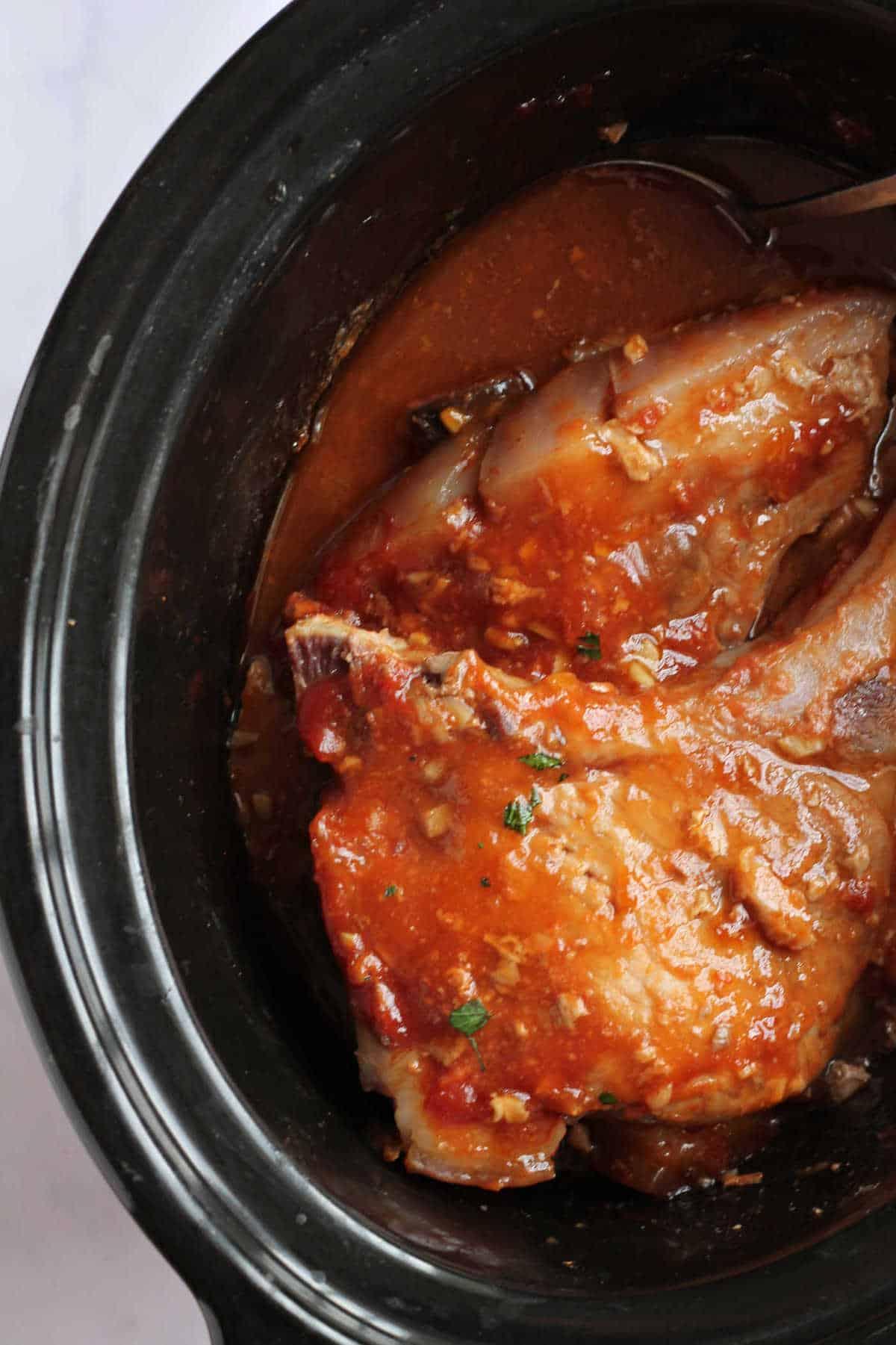 Slow cooker with honey garlic pork chops.