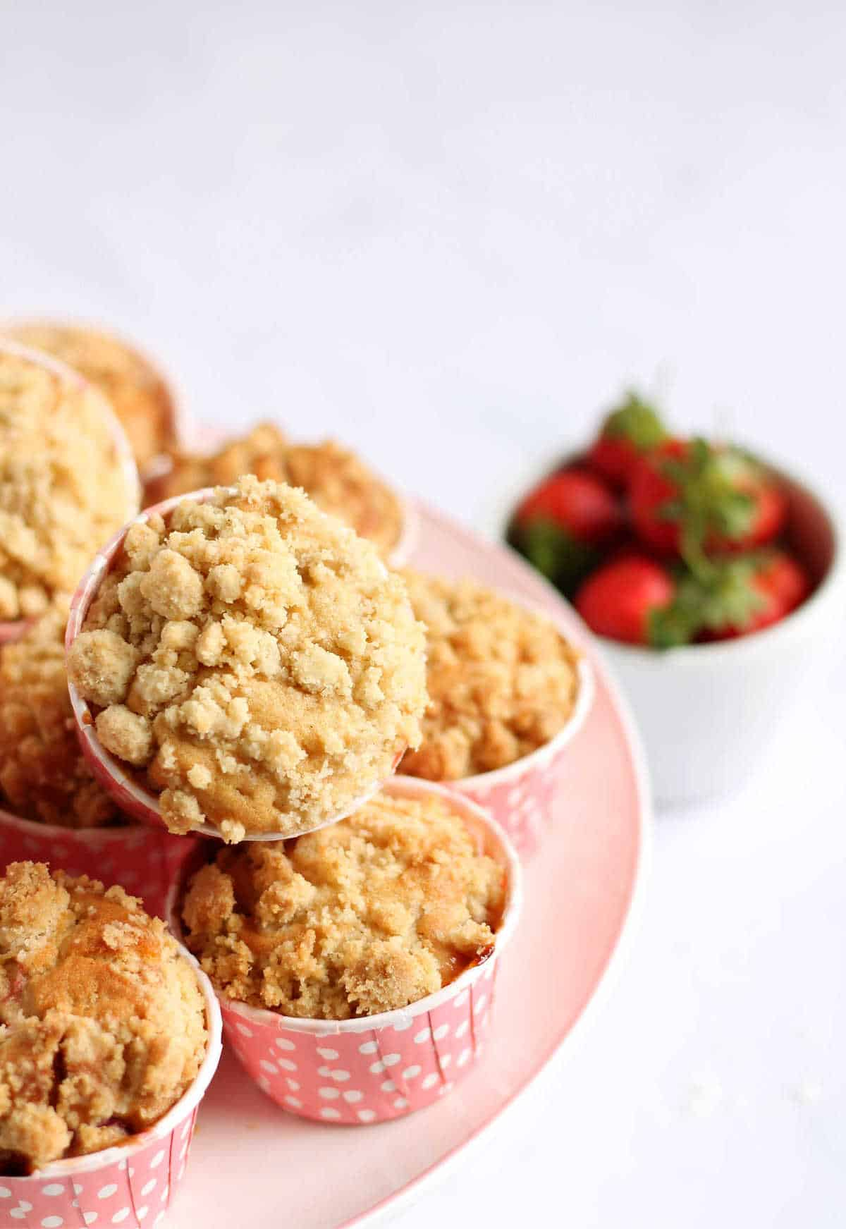 Strawberry muffins on a cake stand.