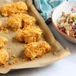 cornflake chicken nuggets on baking tray