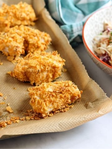 cornflake chicken nuggets on baking tray