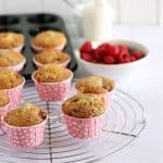 raspberry and white chocolate muffins on a cooling rack
