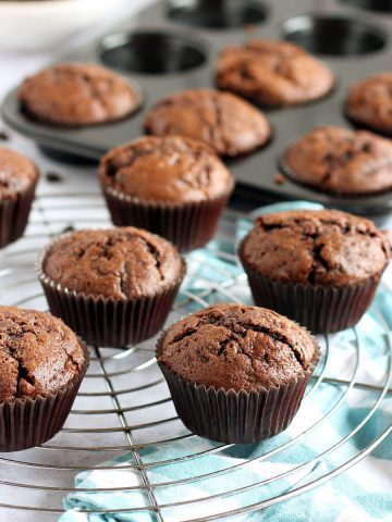 Chocolate courgette muffins om a cooling rack.