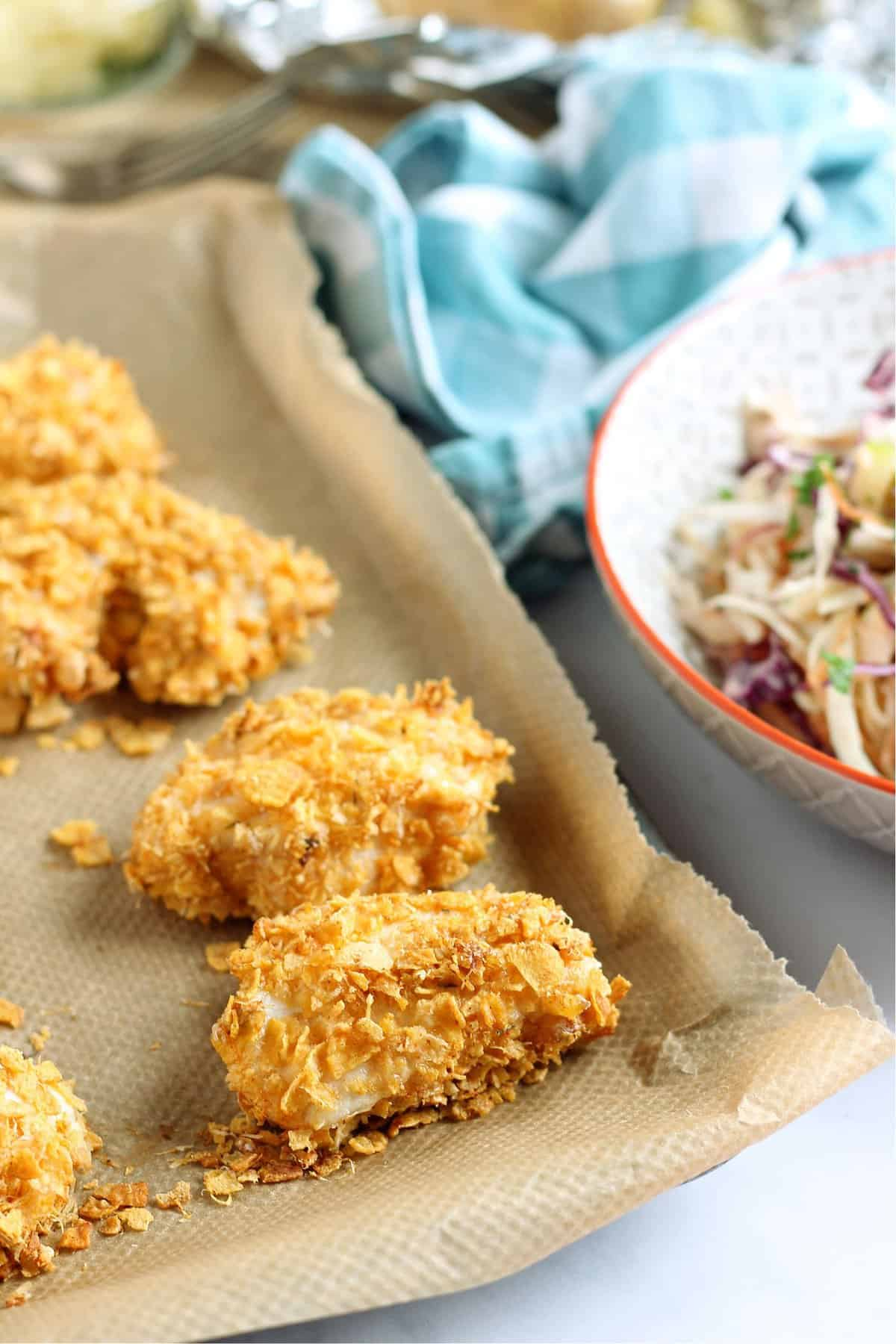 Homemade nuggets with apple slaw
