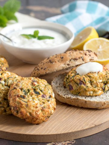 courgette and feta burgers with yogurt served in wholemeal rolls