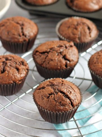 chocolate muffins with grated courgette on a cooling rack