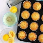 Lemon drizzle muffins in muffin tin.