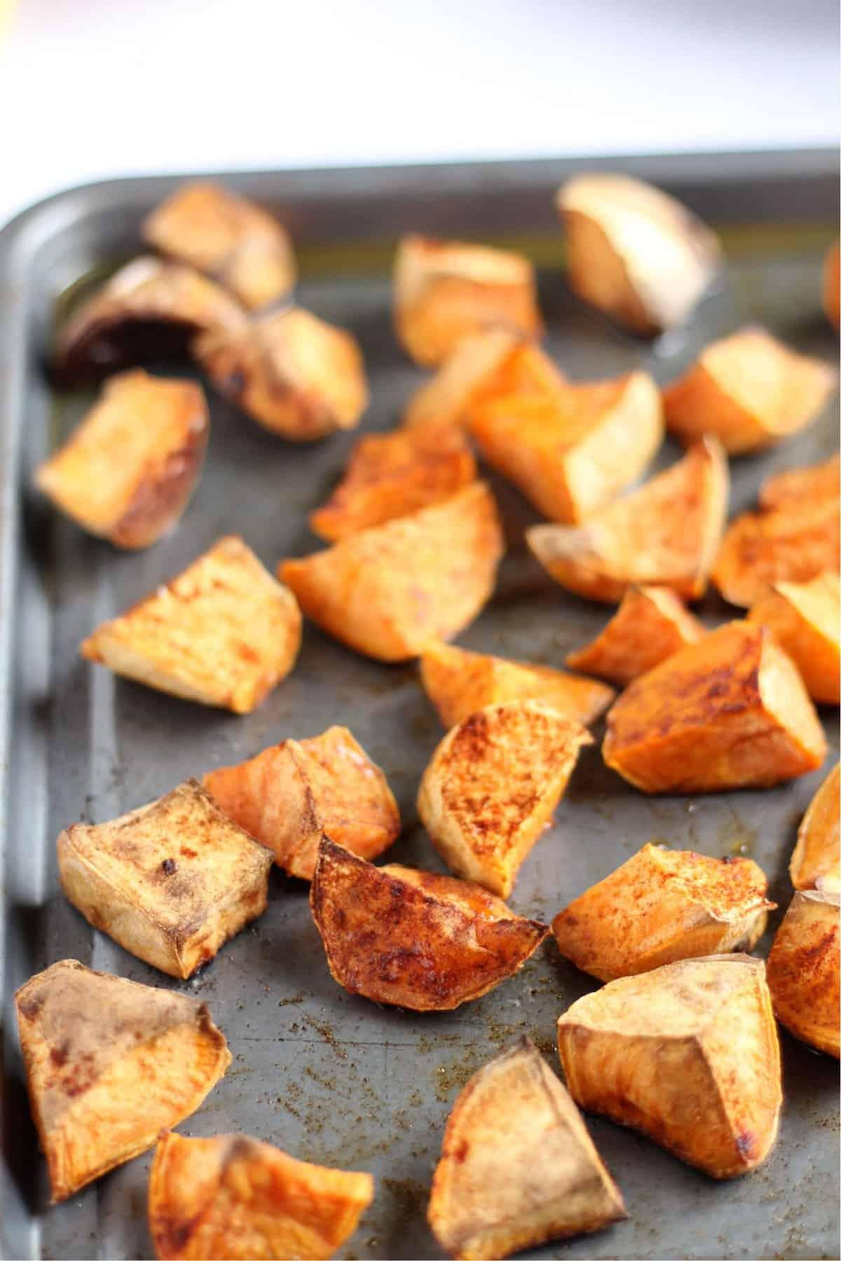 A tray of roast sweet potato chunks
