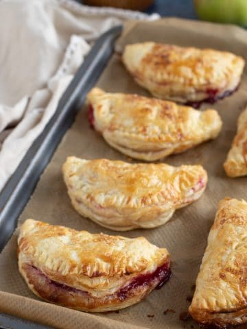 Apple and Blackberry Turnovers on a baking tray.