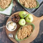 overhead shot of mincemeat and apple crumble with clotted cream.