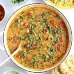 Chickpea and spinach curry in a pan.