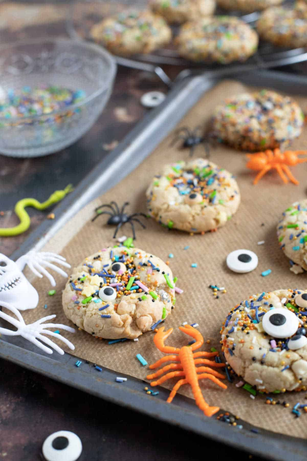 Halloween sprinkle cookies on a baking tray.