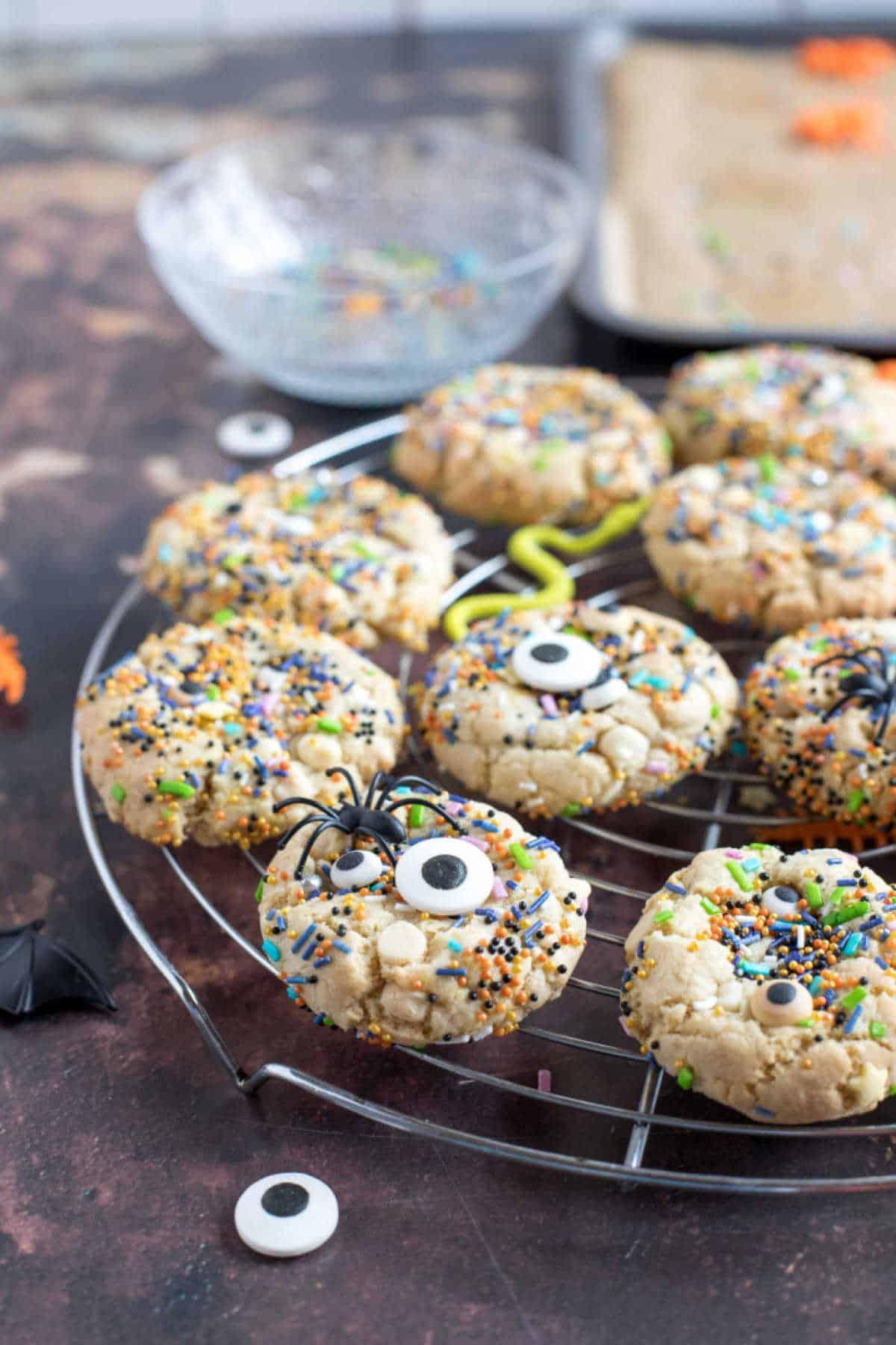 Halloween sprinkle cookies on a cooling rack.