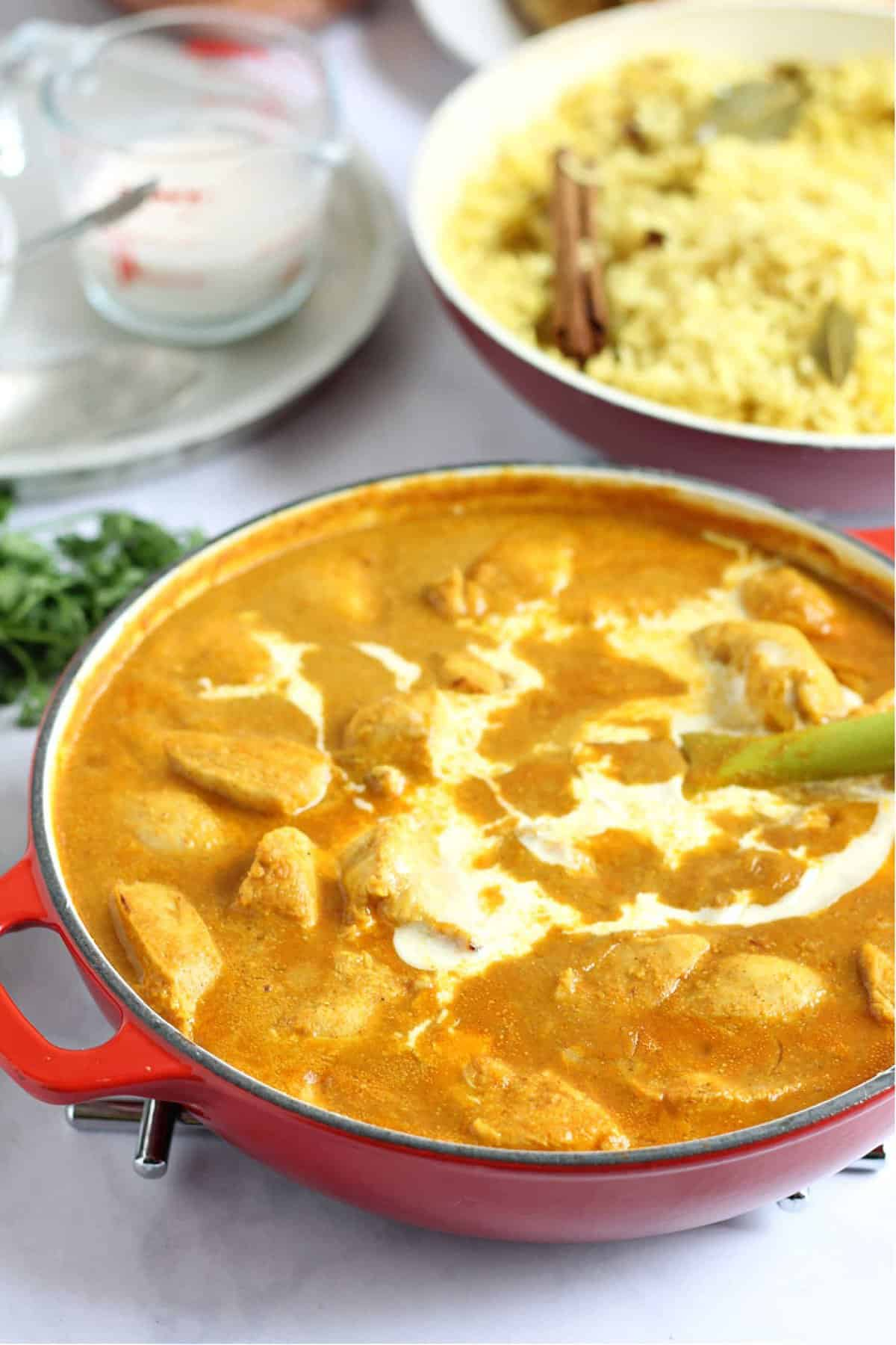 Mild chicken curry in a pan, drizzled with double cream.