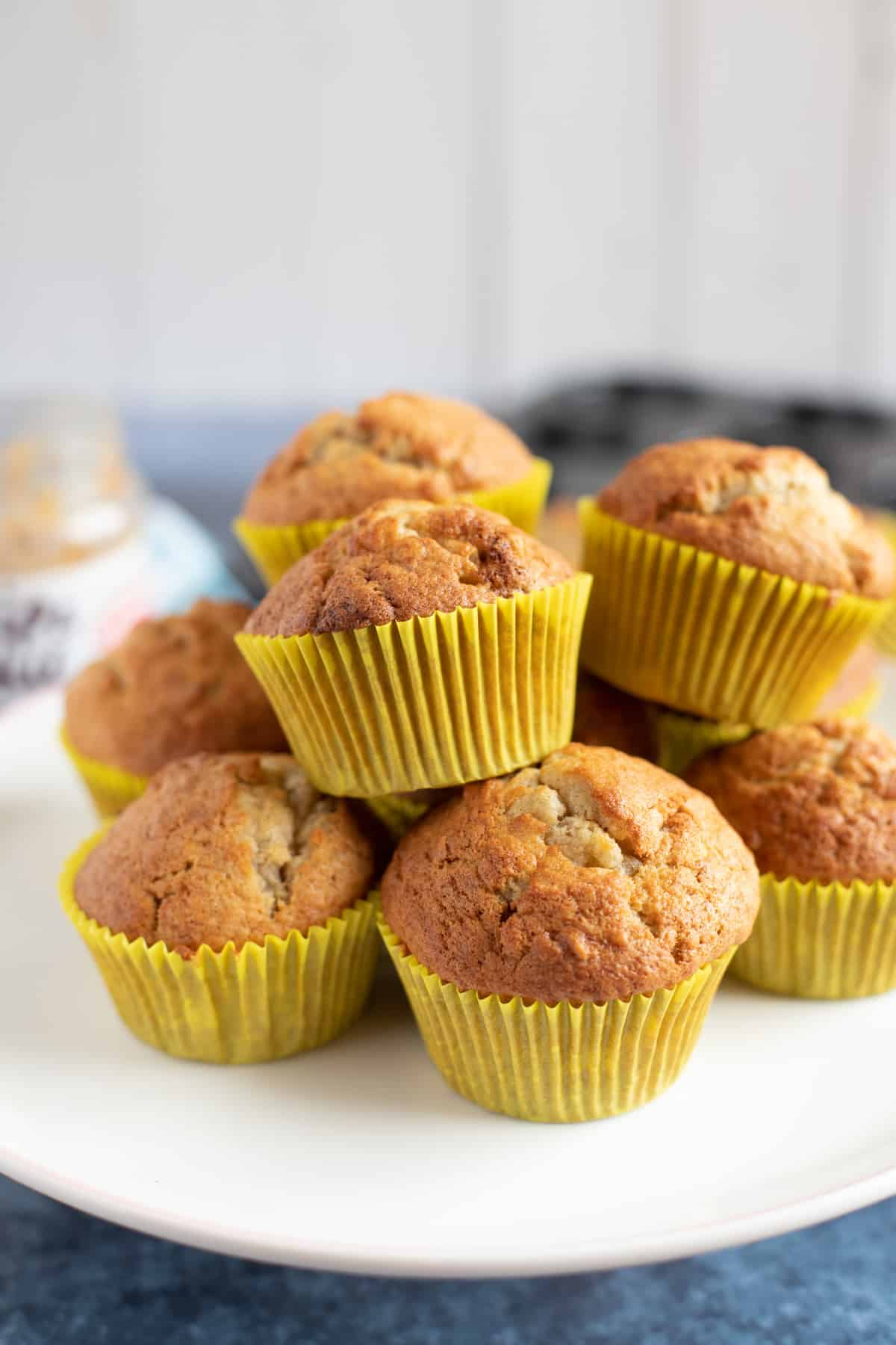 Peanut butter and banana muffins on a cake stand.