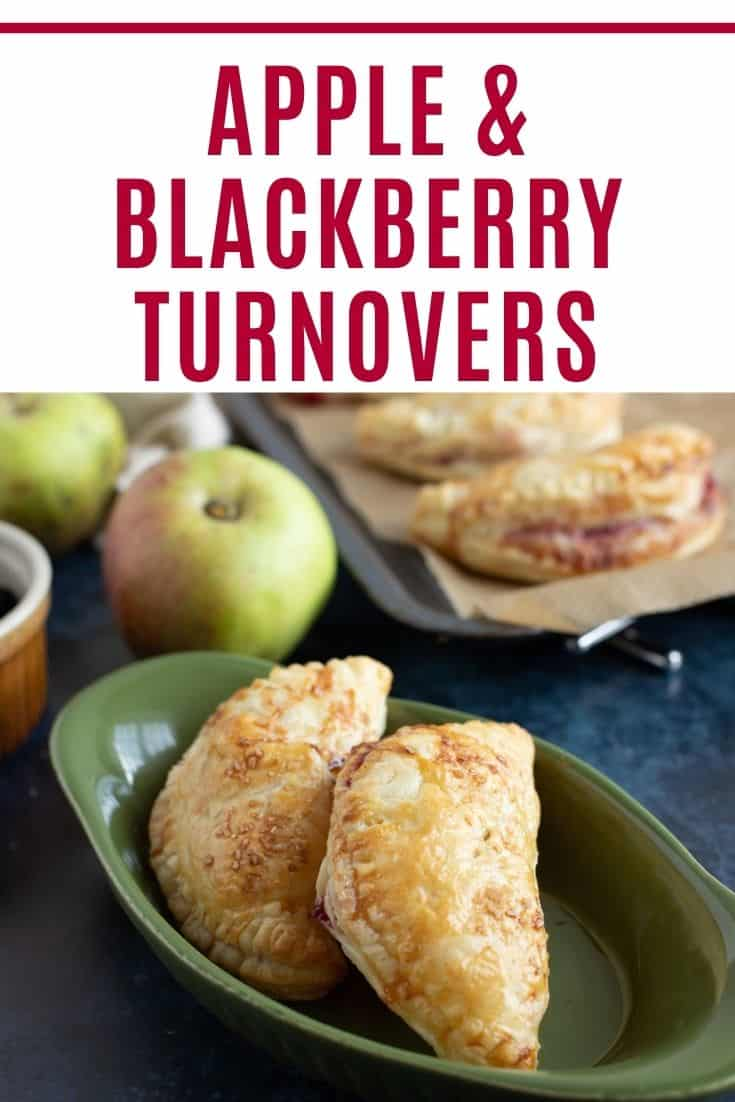 Apple and blackberry turnovers in a serving bowl pinterest image with text overlay.
