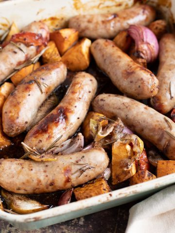 Sticky Sausage Traybake in a roasting pan.