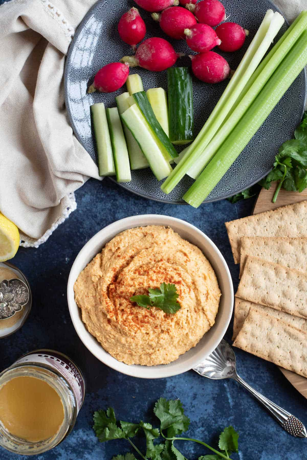 A bowl of homemade Moroccan hummus with fresh raw vegetables.