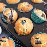 Blueberry and white chocolate muffins in a muffin tin.