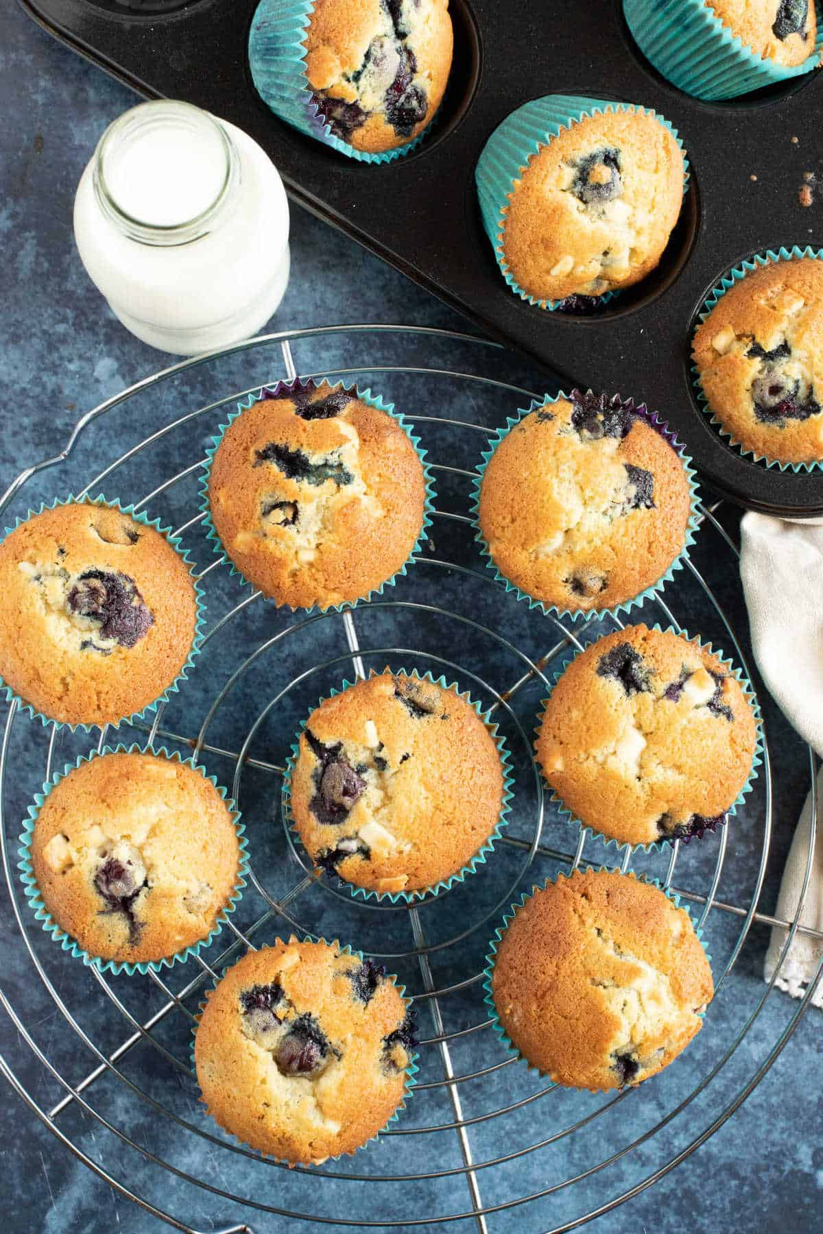 Blueberry muffins on a wire cooling rack.