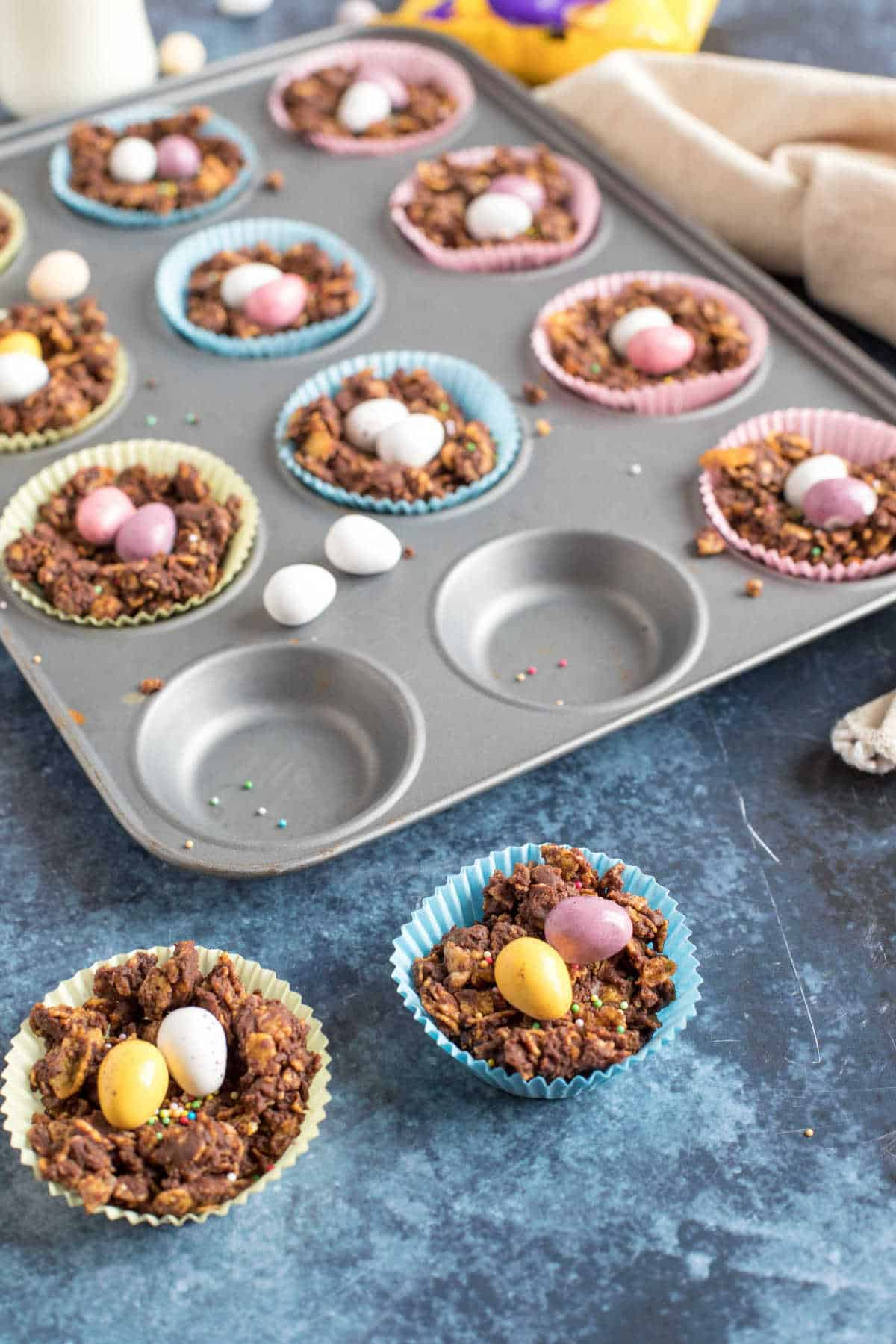 Cornflake cakes with mini eggs.