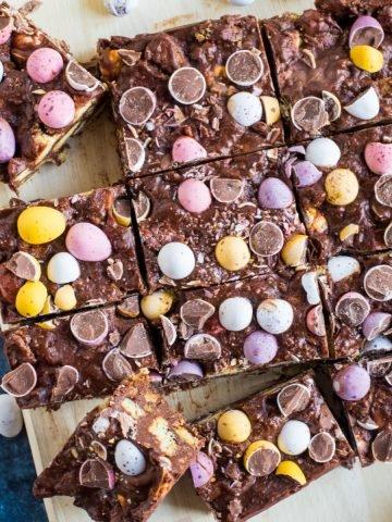 Chocolate mini egg tiffin cut into squares.