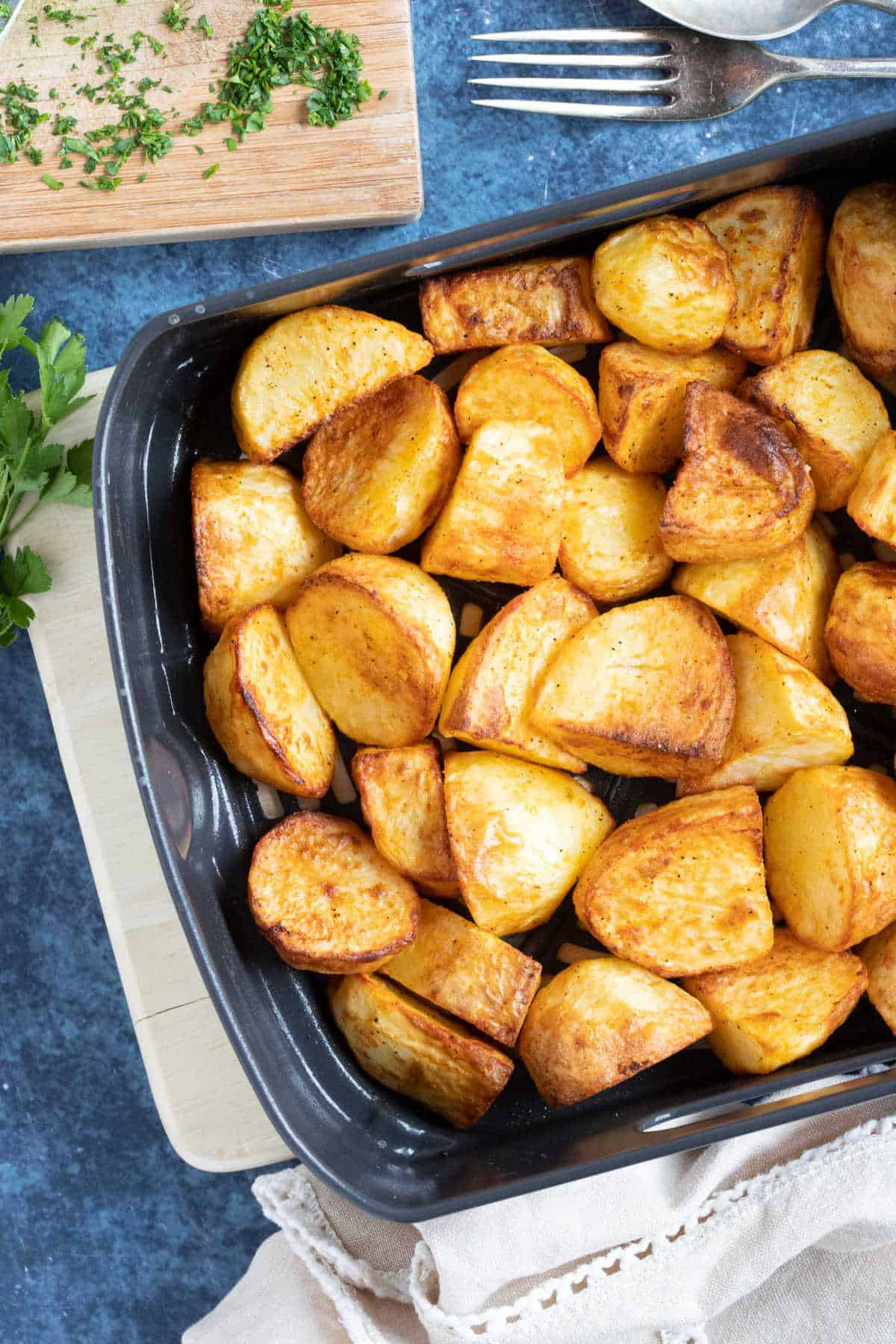Roast potatoes in an air fryer basket.