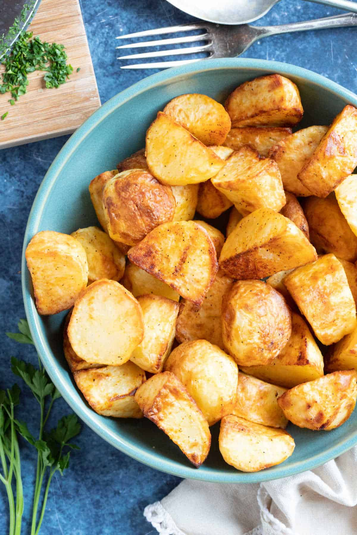 Roast potatoes in a serving dish.