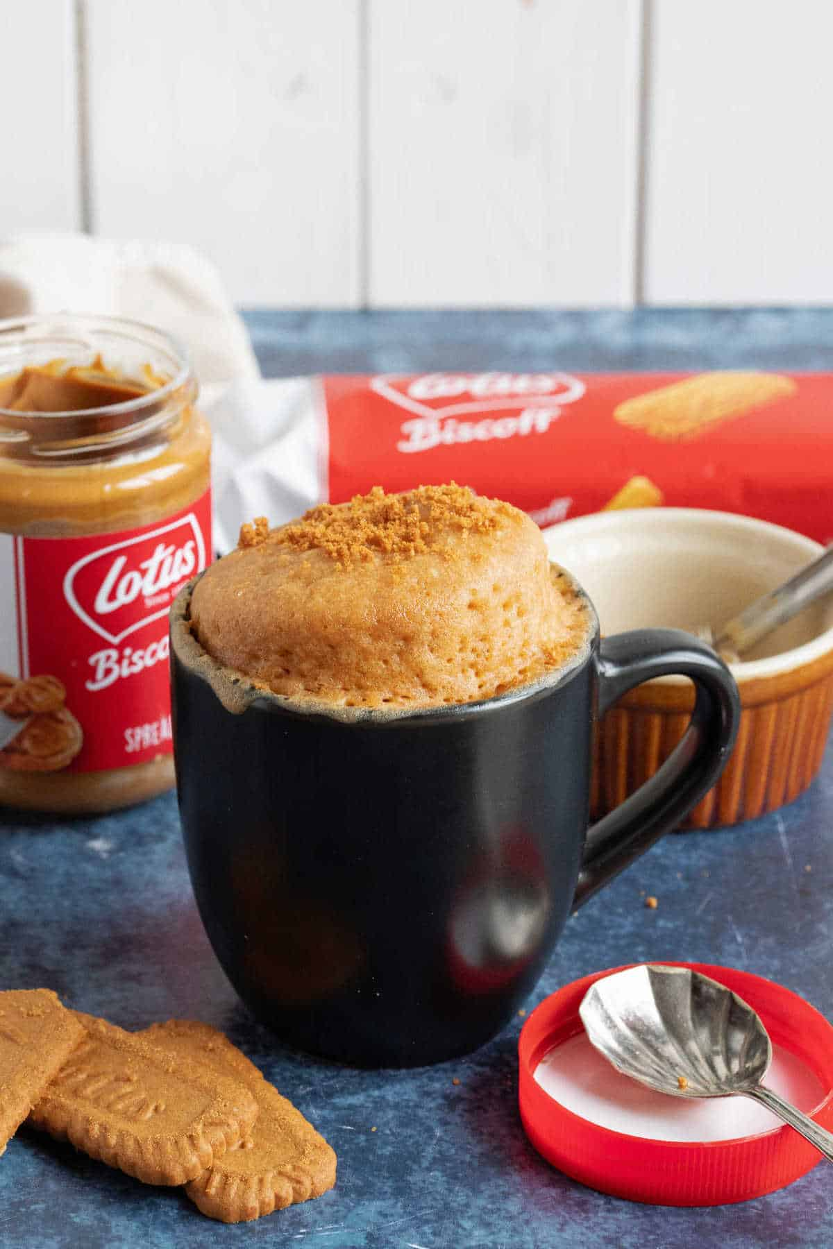 Mug cake with biscoff spread jar.