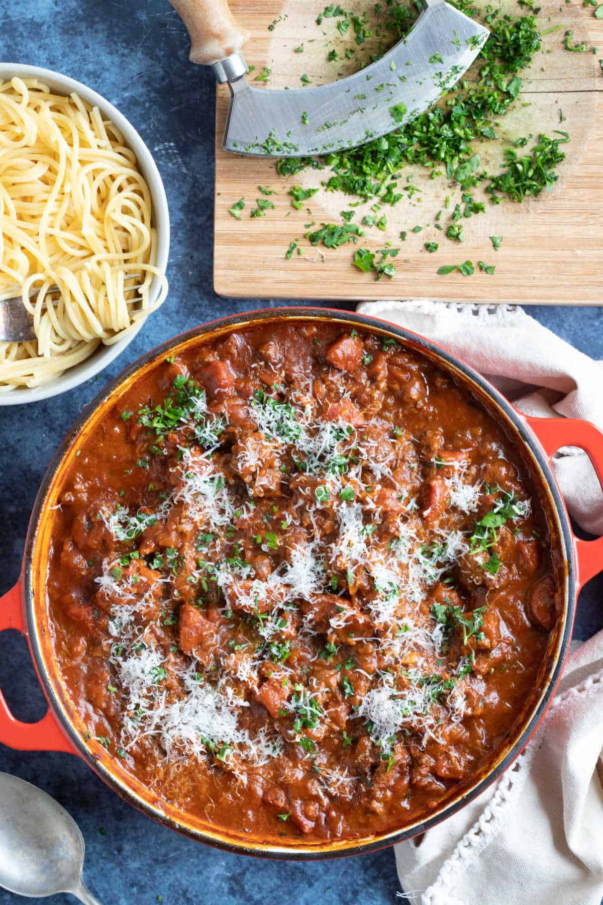 A pan of smoky chorizo bolognese with spaghetti.