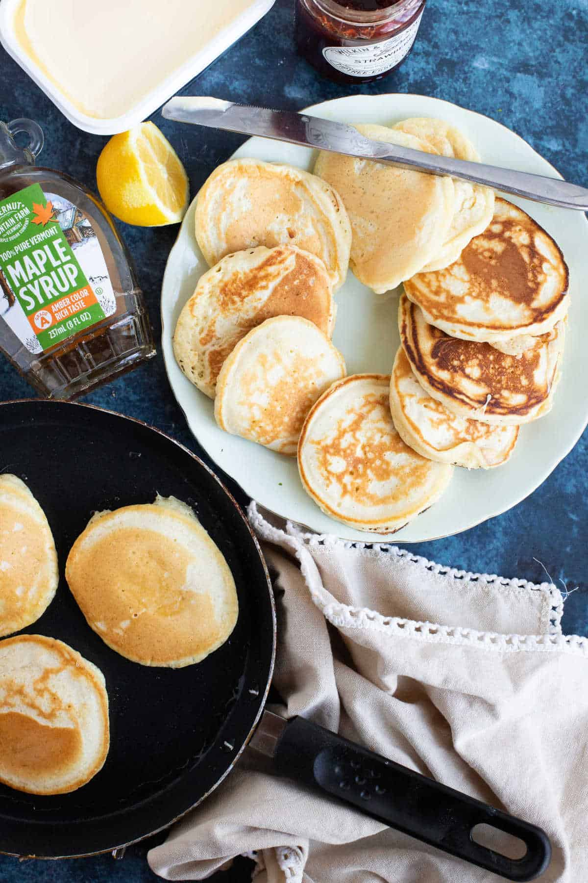 A plate of drop scones (scotch pancakes with maple syrup.