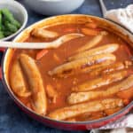 Easy sausage casserole in a red pan.