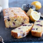 Sliced lemon polenta cake with blueberries.