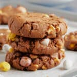 A stack of chocolate mini egg cookies.