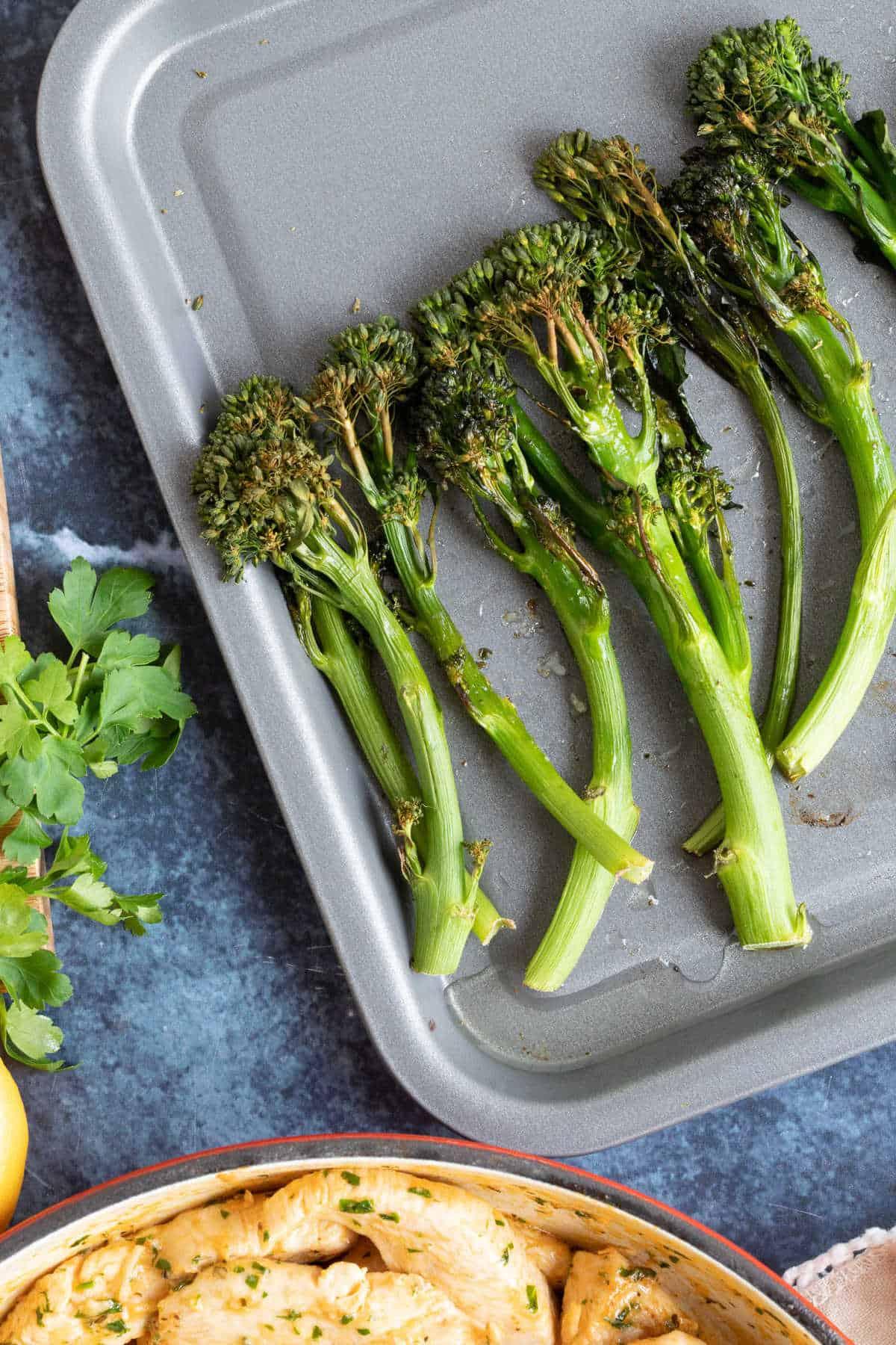 Tenderstem broccoli on a baking sheet.