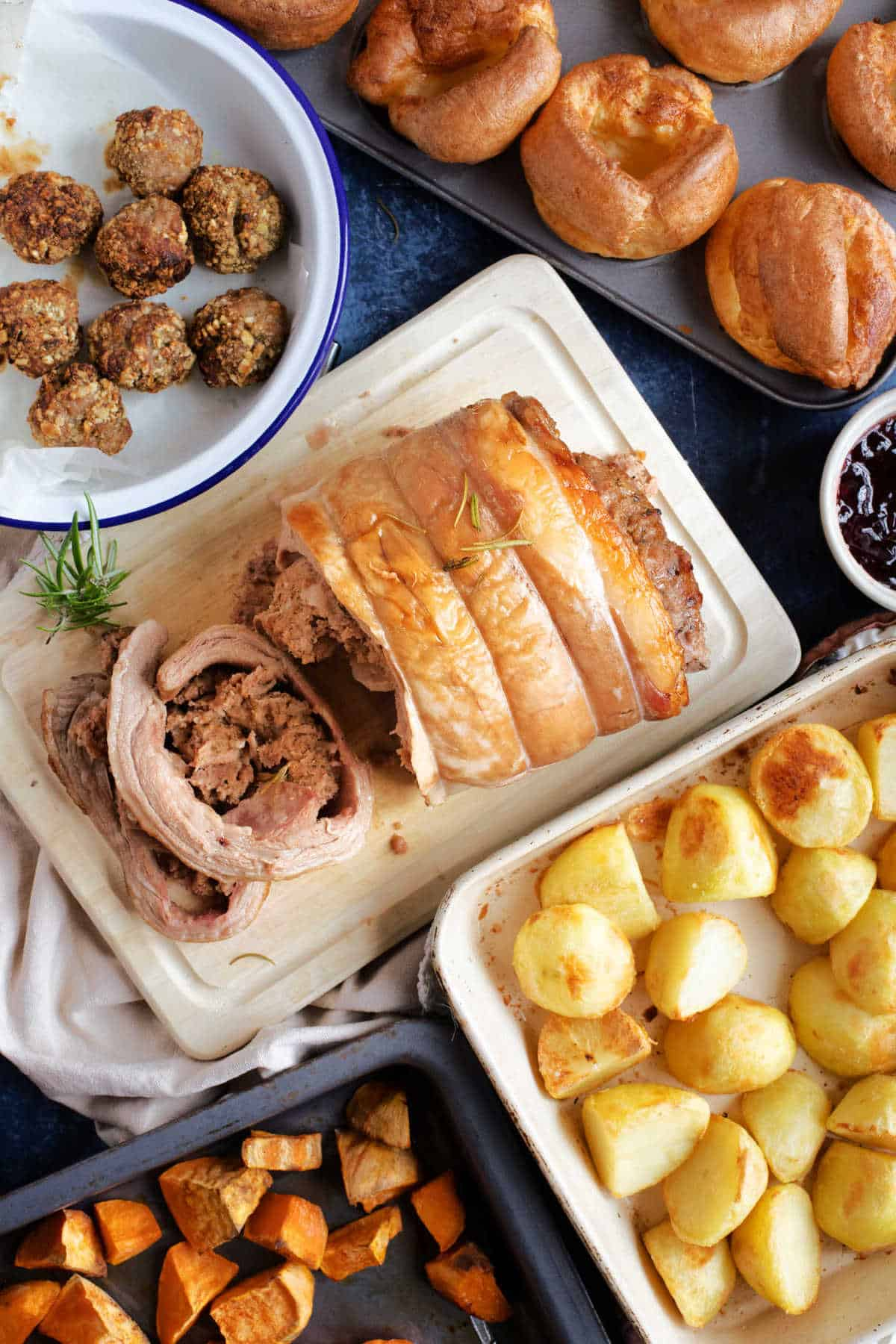 Slow cooker breast of lamb with Yorkshire puddings, potatoes and stuffing.
