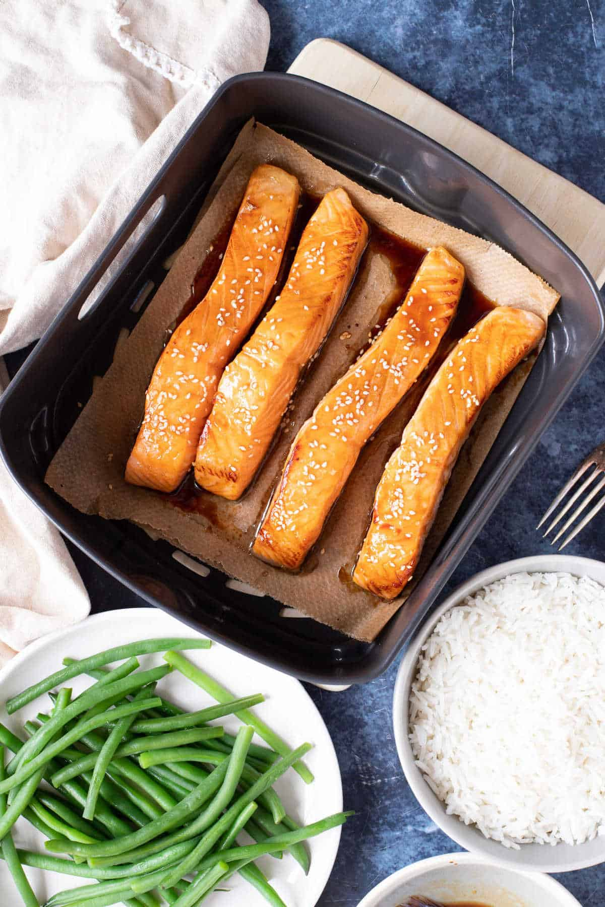 Honey glazed salmon made in the air fryer with rice and green beans.