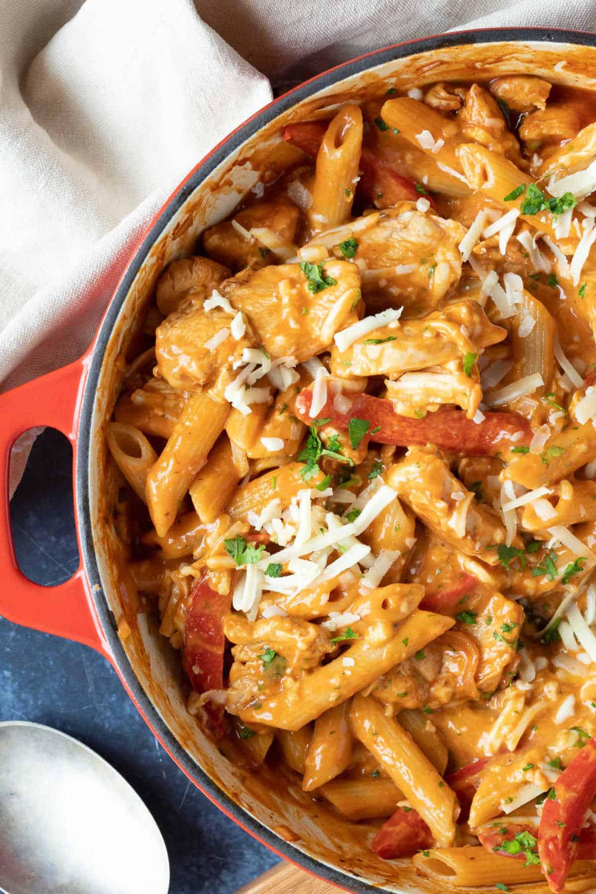 Creamy BBQ chicken pasta in a red casserole.