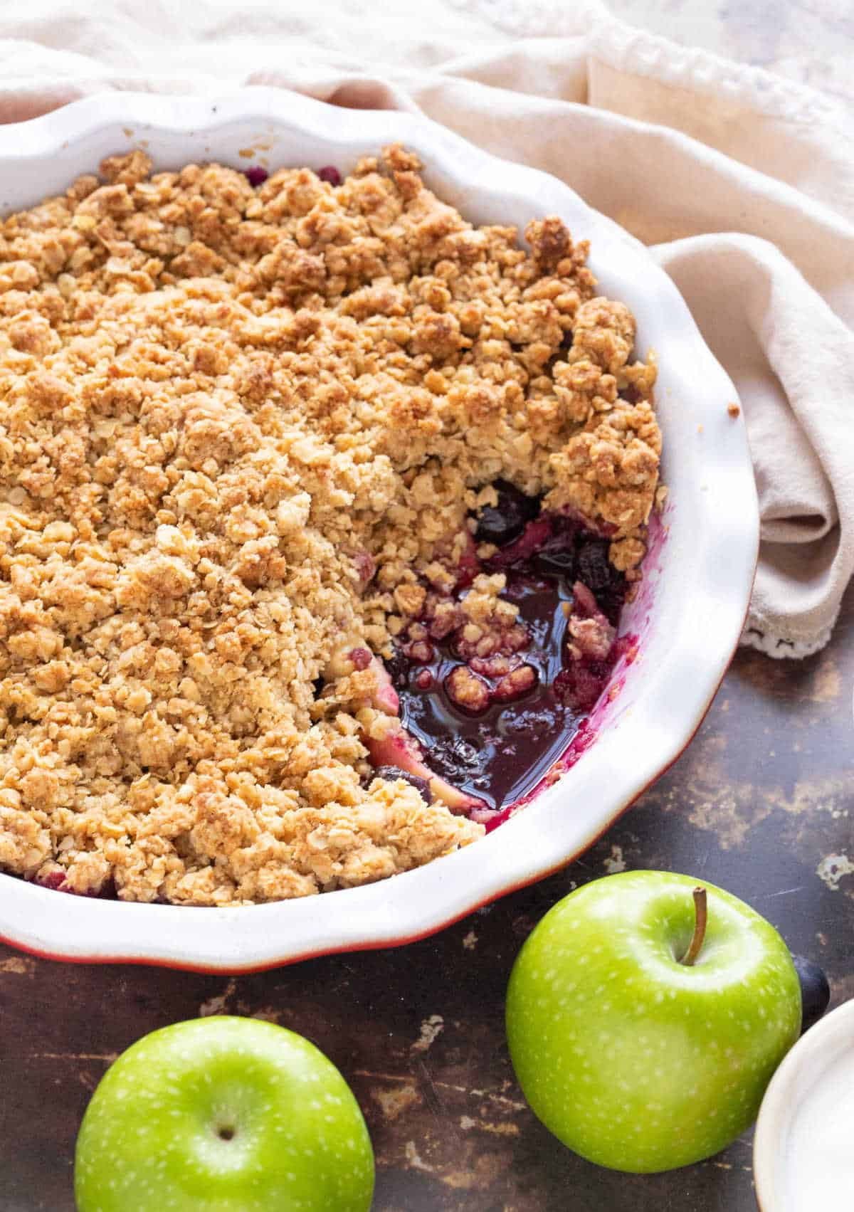 Apple and blueberry crumble in a pie dish.