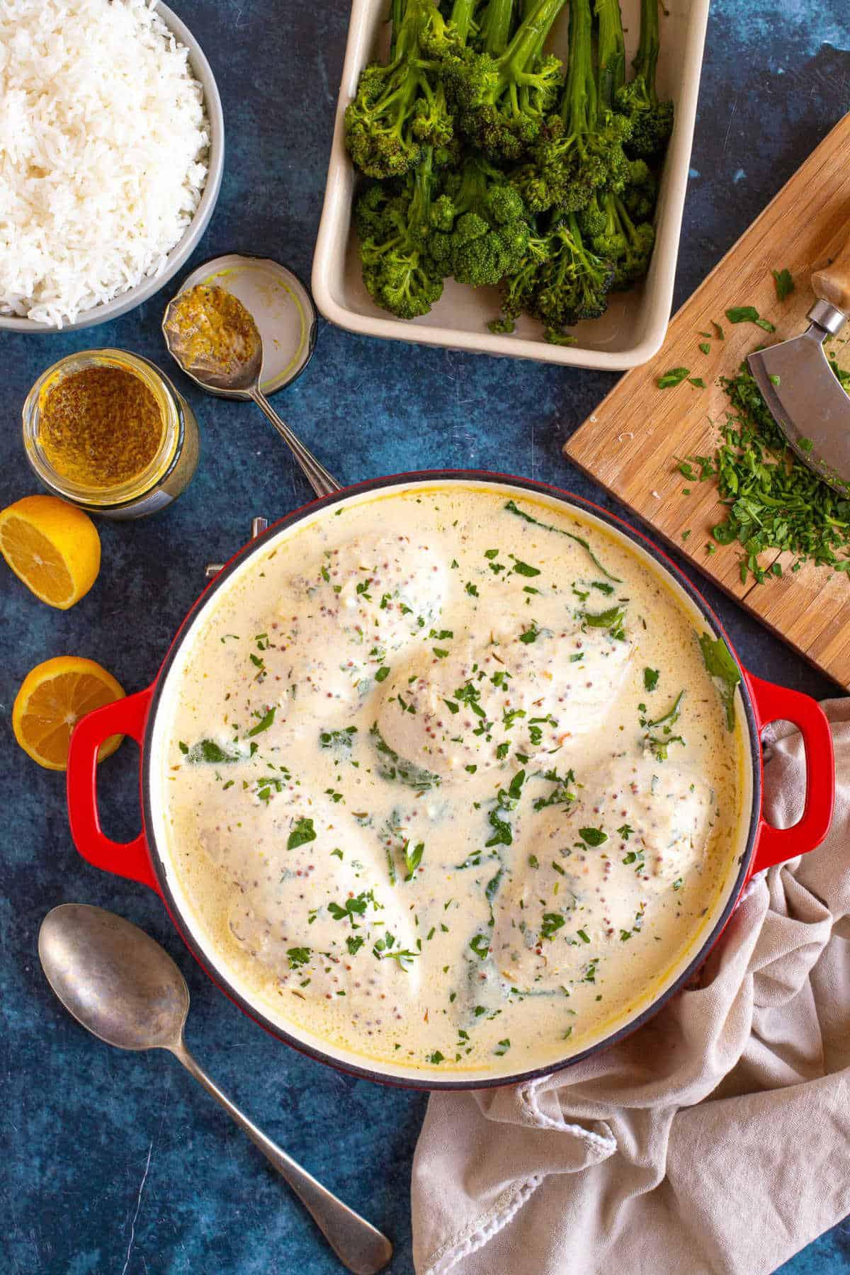 Crème fraiche chicken in a red pan.