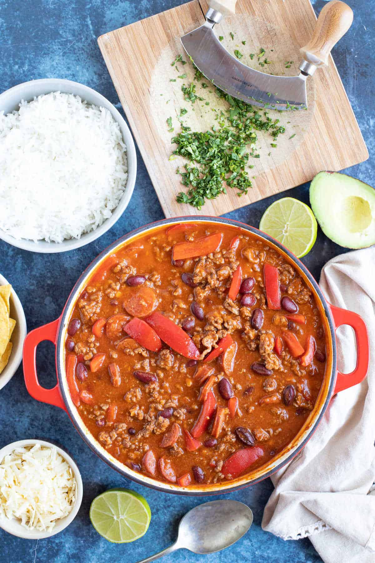 Mild chilli con carne in a red pan with rice.