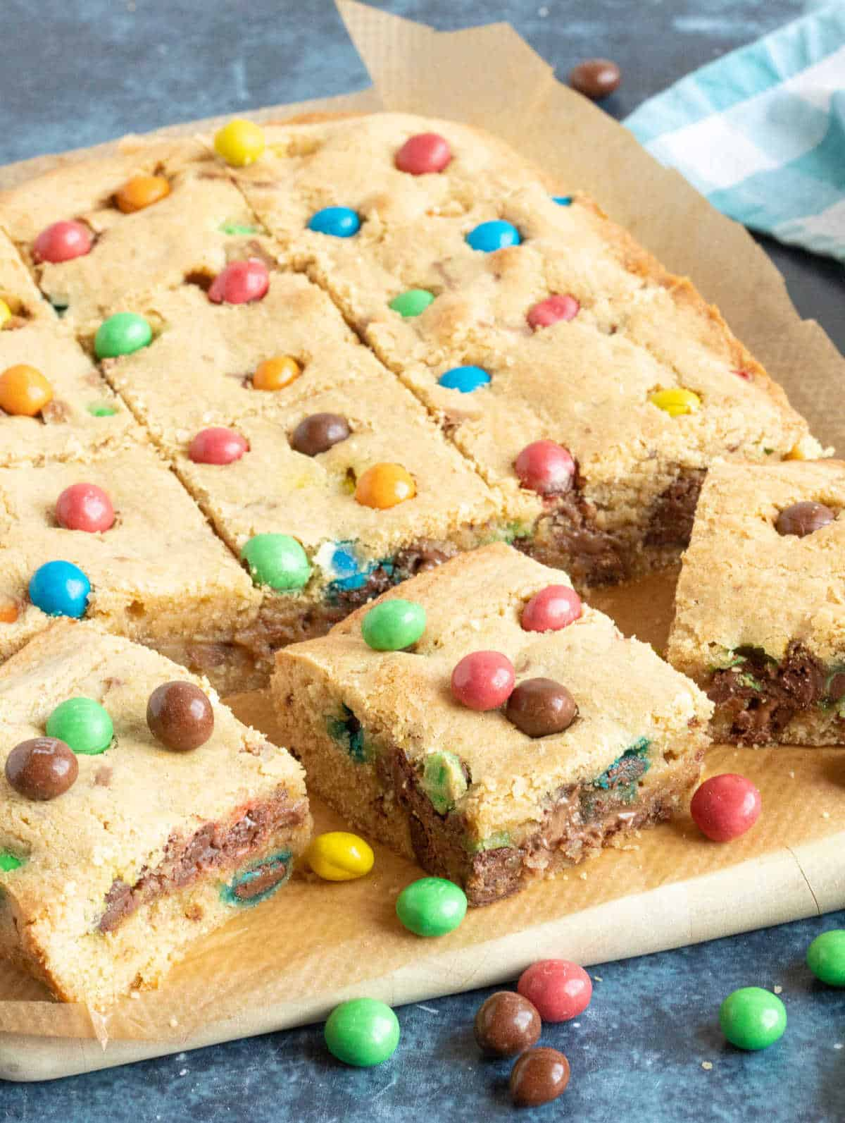 M&M cookie bars cut into slices.