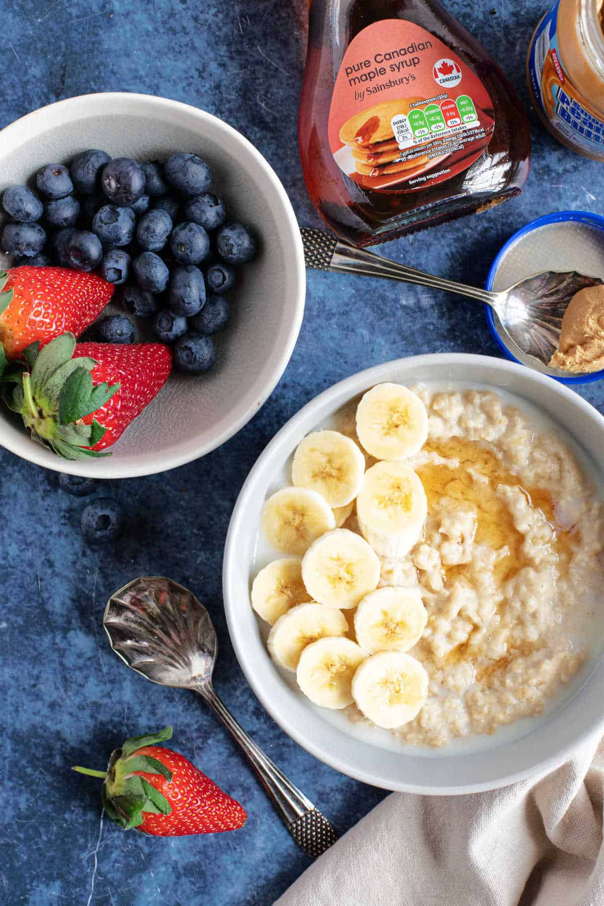 A bowl of peanut butter porridge. with fresh berries.