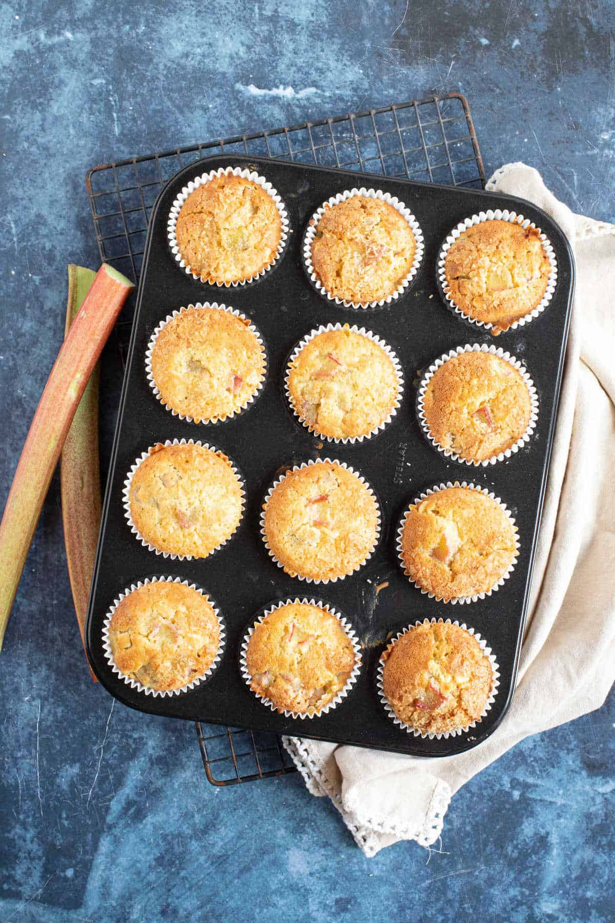 Rhubarb muffins in a muffin tray.