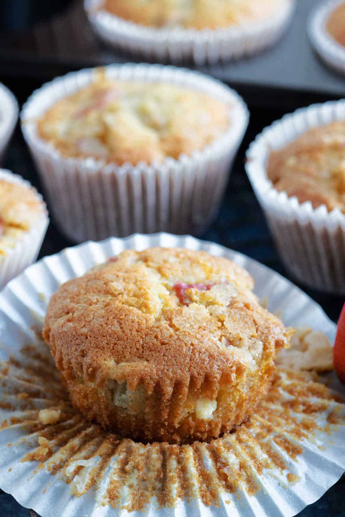 A rhubarb muffin with white chocolate chips.