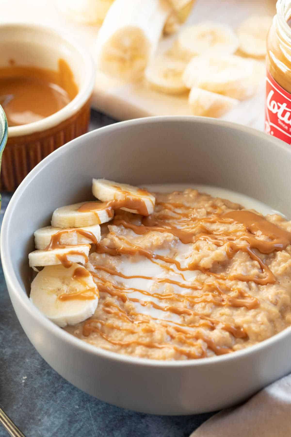 Biscoff porridge in a grey cereal bowl.