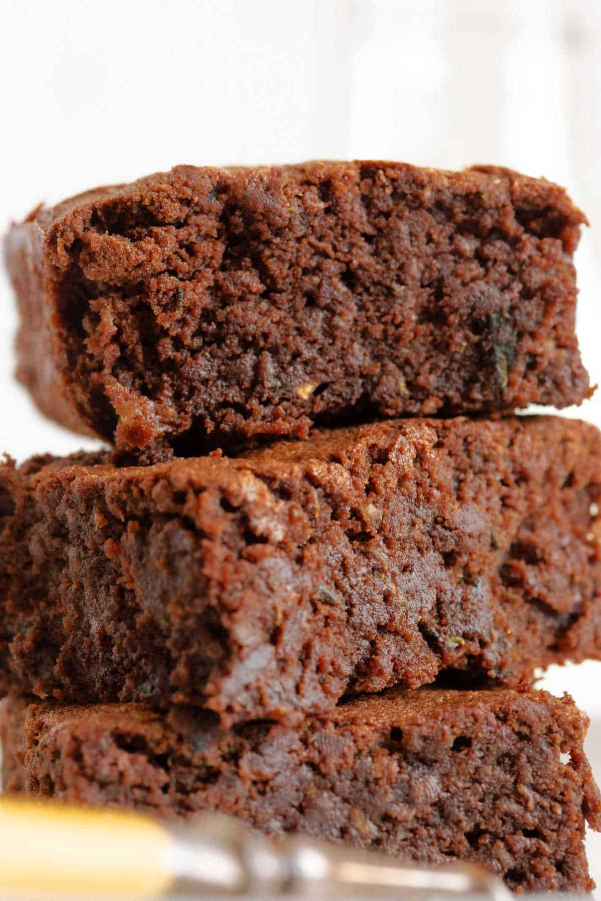 A close up photo of a chocolate courgette brownie.
